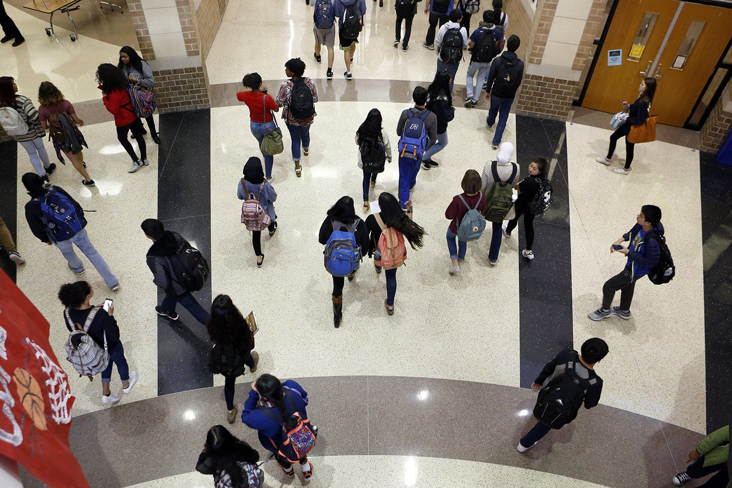 Students crowd the hallway after the last bell rings at Liberty High School in Frisco.