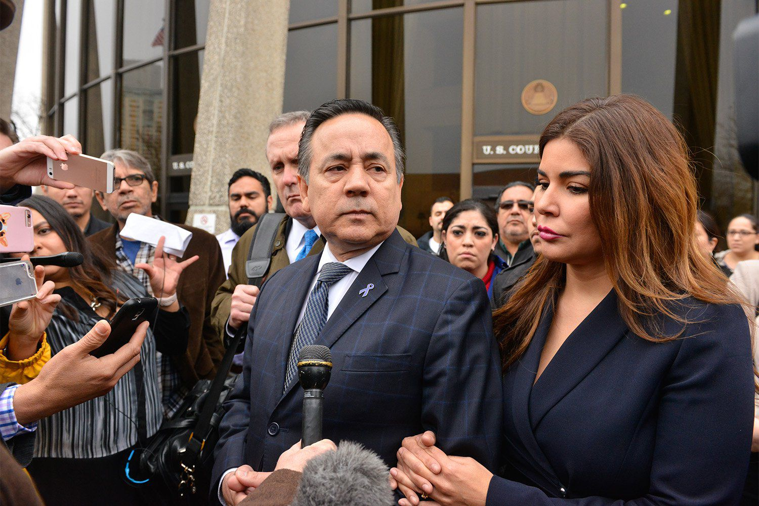 State Sen. Carlos Uresti, D-San Antonio, along with his wife Lleana, leaves the federal courthouse in San Antonio after being convicted on 11 charges on Thursday morning, Feb 22, 2018.