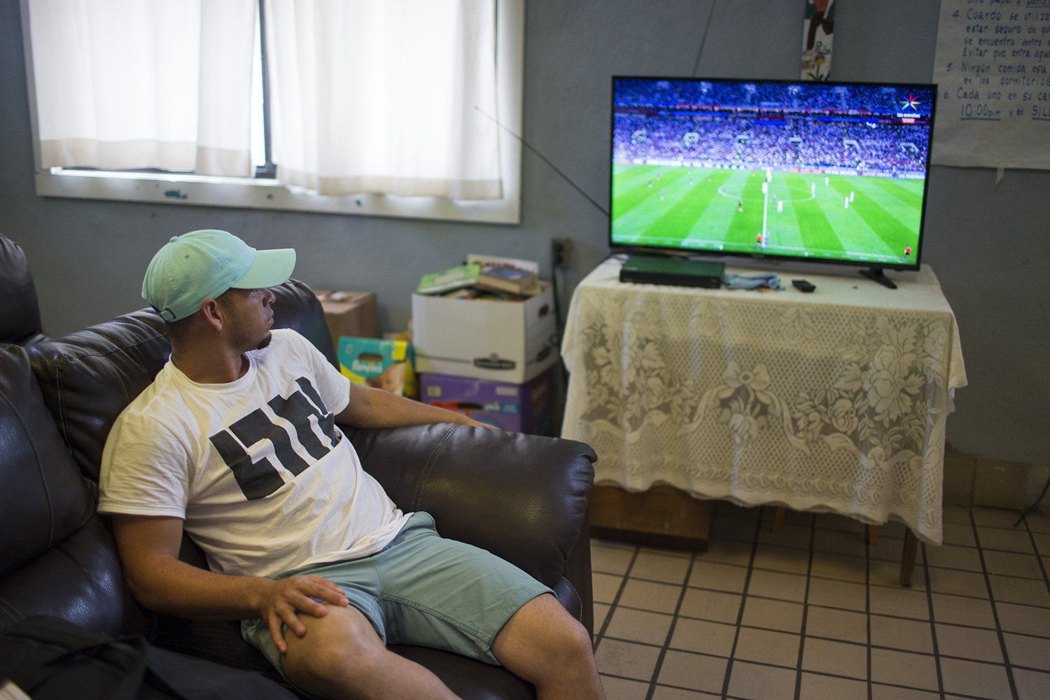 Mario (first name only given) watches the World Cup semi-final at the Casa Vides Annunciation House in El Paso on Wednesday, July 11, 2018. Mario was reunited with his 10-year-old daughter, who had been staying at a nearby shelter, less than a week later.