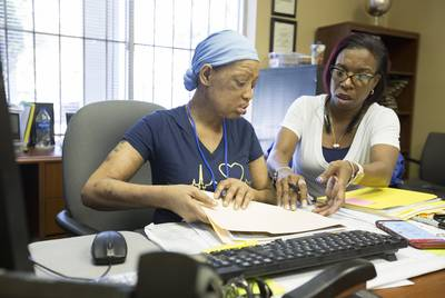 Denise Taylor (right), who has a Section 8 housing voucher but has been unsuccessful finding a place to live, continues to search at the Houston office of Realtor Pamela Banks on April 19, 2018.