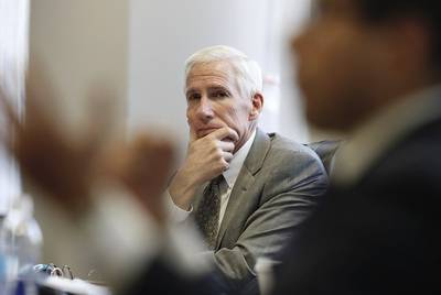 Former Texas Supreme Court Justice Scott Brister, chairman of the Texas Commission on Public School Finance, listens to a commission member at the panel's second meeting on Feb. 8, 2018.