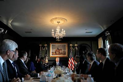 U.S. President Donald Trump participates in a roundtable discussion with state leaders, including Texas Attorney General Ken Paxton, on prison reform in Bedminster, New Jersey on August 9, 2018. | by REUTERS/Carlos Barria
