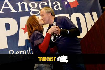 Angela Paxton kisses her husband, Texas Attorney General Ken Paxton, at her primary election night watch party inAllen on Tuesday, March 6, 2018.