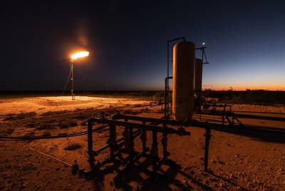 A gas flare burns bright on a production site northeast of Andrews in the Permian Basin of West Texas.