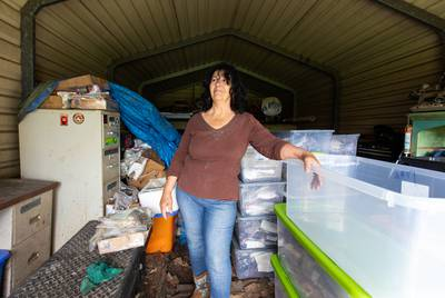 Diane Wilson takes a break from organizing bins containing thousands of plastic pellets that she and other activists have collected from Lavaca Bay and Cox Creek over the past three years.