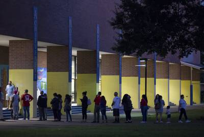Voters Wait In Line Outside A Houston Polling Place