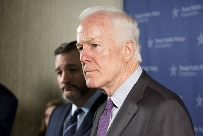 U.S. Sens. John Cornyn, right, and Ted Cruz of Texas speak to media following the Texas Public Policy Foundation's annual policy orientation in Austin in January.