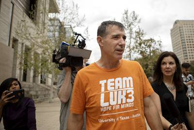 The University of Texas men's tennis coach Michael Center exited the U.S. Federal Courthouse in Austin on March 12, 2019.