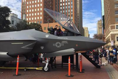 Fort Worth residents posed for photos on Dec. 21, 2016, with a model of the F-35 fighter plane, which is manufactured at a Lockheed Martin plant in the city.