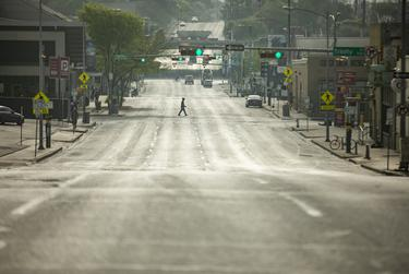Seventh Street is mostly empty during morning rush hour in downtown Austin.