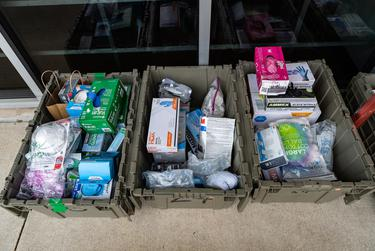Austinites drop off medical personal protective equipment into bins outside Bicycle Sport Shop. Once full, employees will donate the equipment to local hospitals to help fight a shortage of personal protective equipment in Austin. March 22, 2020.