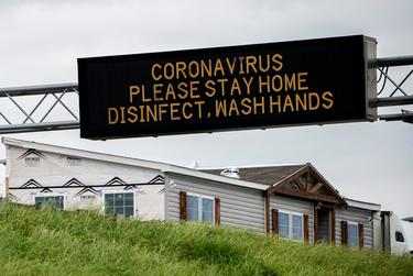 A sign in Montgomery, Alabama, warns drivers to stay home because of the coronavirus.