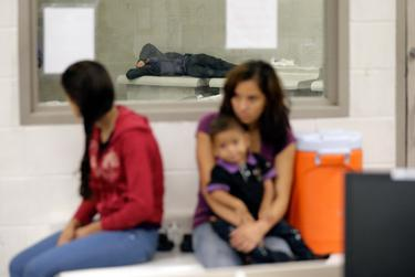 Migrants wait at an immigration processing facility in Texas.