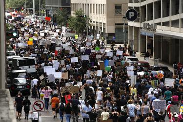Protestors march at a rally for George Floyd in Houston.