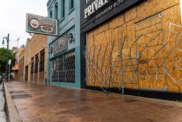 Workers boarded up bars on Sixth Street in Austin after Gov. Greg Abbott closed bars in Texas for the second time in three months because of the COVID-19 pandemic on June 26, 2020.