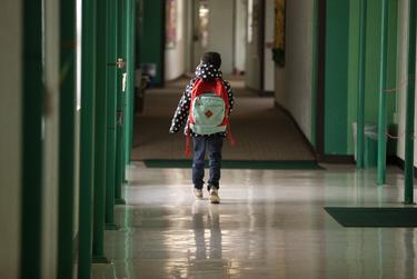 A student walks down the hallway at Cactus Elementary School in Cactus on Jan. 28, 2020.