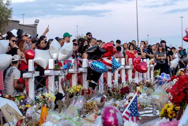 Hundreds mourned the El Paso Walmart shooting victims and their families last year. A new district attorney must weigh whether to prosecute the suspected shooter, whom federal officials also plan to take to trial.