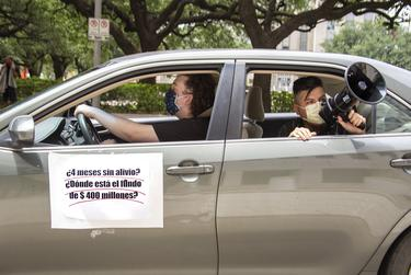 Latino workers gathered for a car protest to demand economic, rental and health relief outside of Houston City Hall on Tuesday. Mayor Sylvester Turner announced a new rent relief program, but opposed a mandatory eviction grace period.