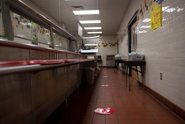 Social distancing decals are posted on the floor in the cafeteria line at Ott Elementary School on Tuesday, Aug. 11, 2020 in San Antonio. Northside ISD installed plexiglass barriers by the cash registers.