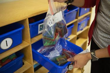 Principal Madeline Bueno shows how classroom learning materials are individually bagged in a classroom at Ott Elementary School on Tuesday, Aug. 11, 2020 in San Antonio. The learning materials will be sanitized after each use, Bueno said.