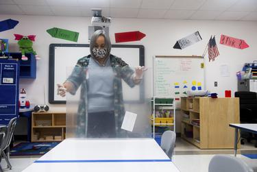 Early College coordinator Byllye Benavides measures a plastic partition on a desk at Premont Ernest H. Singleton Early College Academy on Tuesday, Aug. 4, 2020 in Premont. The school is hand-making many of its safety precautions, such as the plastic partitions.