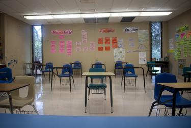 Desks are seated six feet away from each other at Premont Collegiate High School on Tuesday, Aug. 4, 2020 in Premont. Some desks, marked with yellow Xs, were used as placeholders to maintain a socially safe distance. A teacher put a blue table at the front of the room to remind students to maintain distance from the teacher.
