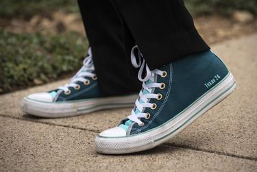 """Candace Valenzuela, candidate for Texas' 24th Congressional District, sports her custom Converse shoes with """"Texas 24"""" lettering on the side of the shoes, outside her home in Dallas on July 29, 2020."""