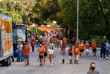 Fans begin to arrive at the stadium before kickoff for the first home football game of the season at the University of Texas at Austin on Sept. 12, 2020.