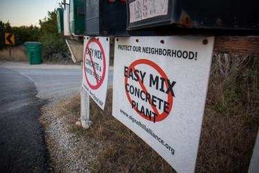Hays County resident Lynn Ross owns one of the properties near a concrete batch plant in the Signal Hill neighborhood. As the number of concrete and other aggregate material plants continues to increase across Texas, tensions have risen amongst neighboring residents. Lynn Ross and her husband are pictured at their property in Austin on Nov. 18, 2020.