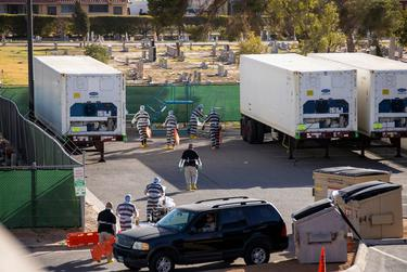 """El Paso County detention inmates, also known as """"trustees"""" (low level inmates) help move bodies to mobile morgue units outside the Medical Examiner's Office, Saturday, November 14, 2020, in El Paso, TX. Due to the Covid-19 surge of positive cases and deaths in recent weeks in El Paso, the Medical Examiner's Office has asked the jail for help."""