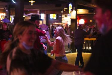 Guests dance at Billy Bobís Texas, a honky-tonk in Fort Worth. Billy Bobís has been operating since August 13 under food and beverage guidelines after previously being classified as a bar. Bars that did not already get the food and beverage license were allowed to reopen October 14 at 50% capacity, and must stop selling alcohol by 11 pm.