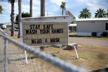 A sign urges resident to stay safe during the COVID-19 pandemic in Hidalgo County. Dec. 7, 2020.