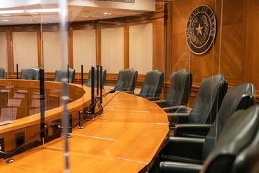 A committee hearing room featuring plexiglass dividers on Jan 4, 2021.