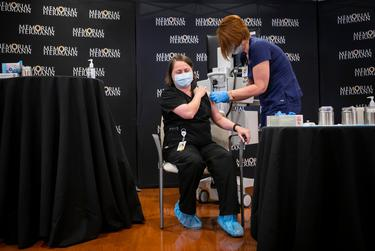 Infectious Disease Specialist Dr. Linda Yancey receives the fifth Pfizer COVID-19 vaccine at Memorial Hermann Hospital in the Medical Center in Houston on Dec. 15, 2020.