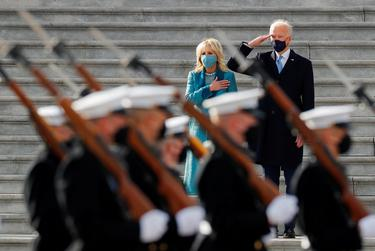U.S. President Joe Biden salutes as first lady Jill Biden puts her hand over her heart during the pass in review after the inauguration ceremony, in Washington, D.C., on Jan. 20, 2021.