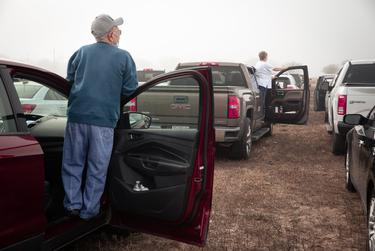 Eager valley residents look amongst the rows of cars lined up at the Rio Grande Valley Livestock Show Grounds in Mercedes. Area residents lined up overnight to receive the COVID-19 vaccine. Jan 5,2021.