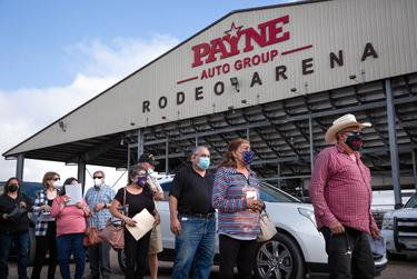 People waited in line to receive the COVID vaccine at the Rio Grande Valley Livestock Show Grounds in Mercedes on Jan. 5, 2021.