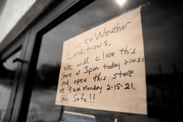 A sign informs customers of a store closure due to the recent winter snowstorm in South Austin. Feb. 16, 2021.
