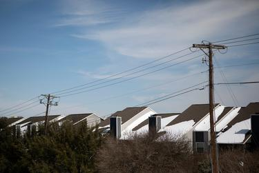 Power lines along a row of homes in South Austin. Many residents experienced power outages due to the winter storm that rolled through Texas. Feb; 16, 2021.