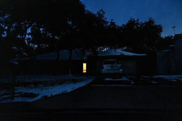 A home in South Austin is lit only by candlelight near the front door as much of Austin was still without power on Feb. 18, 2021.