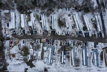 A mobile home park is covered with snow as a massive winter storm continues to engulf  Texas, causing widespread power and water outages across the state. Feb 17, 2021.