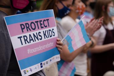 Protestors participate in a rally against Anti-Trans legislation at the southern steps of the state Capitol on April 28, 2021.